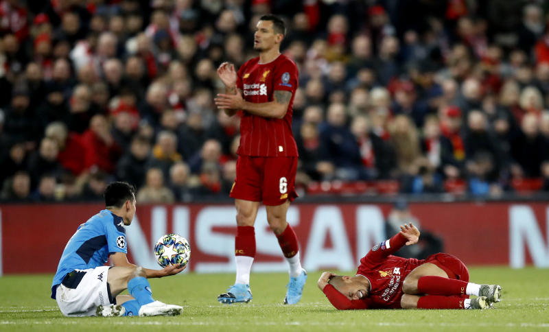 Liverpool's Fabinho lies injured on the pitch during the UEFA Champions League Group E match at Anfield, Liverpool. (Photo by Martin Rickett/PA Images via Getty Images)