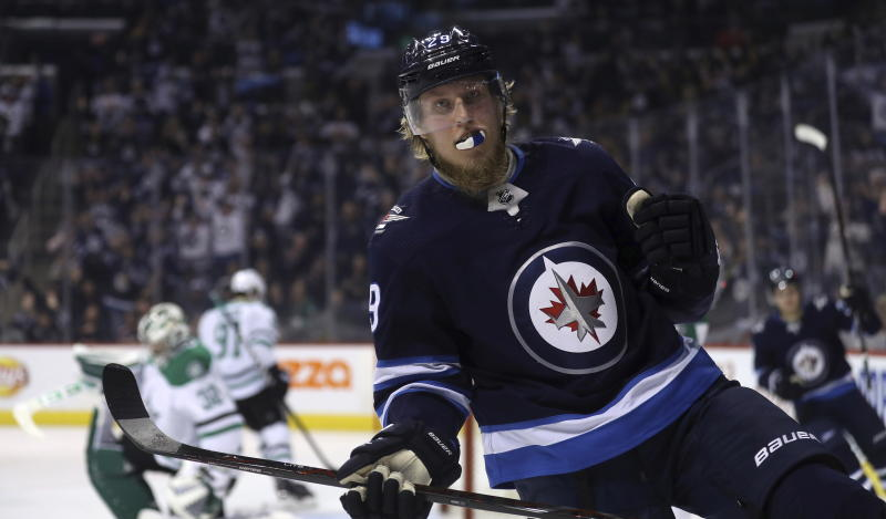 Winnipeg Jets' Patrik Laine celebrates his goal during against the Dallas Stars during the second period of an NHL hockey game Sunday, March 18, 2018, in Winnipeg, Manitoba. (Trevor Hagan/The Canadian Press via AP)