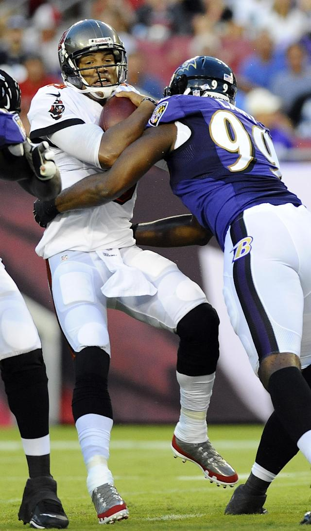 Tampa Bay Buccaneers quarterback Josh Freeman (5) is sacked by Baltimore Ravens defensive tackle Chris Canty (99) during the first quarter of an NFL preseason football game Thursday, Aug. 8, 2013, in Tampa, Fla. (AP Photo/Brian Blanco)