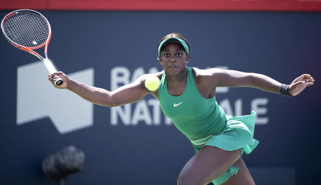 Sloane Stephens, of the Unites States, returns to Carla Suarez Navarro, of Spain, during the Rogers Cup women's tennis tournament, Thursday Aug, 9, 2018 in Montreal. (Paul Chiasson/The Canadian Press via AP)