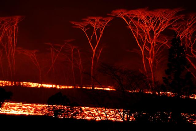 <p>Lava flows on the outskirts of Pahoa during ongoing eruptions of the Kilauea Volcano in Hawaii, June 6, 2018. (Photo: Terray Sylvester/Reuters) </p>