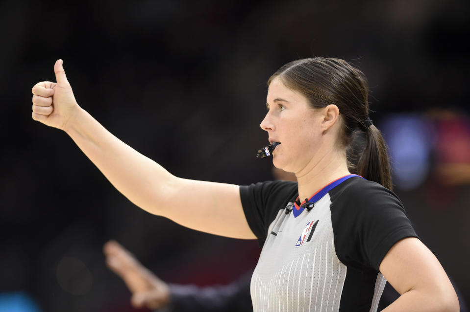 NBA official Natalie Sago signals during the second half between the Cleveland Cavaliers and the Detroit Pistons.