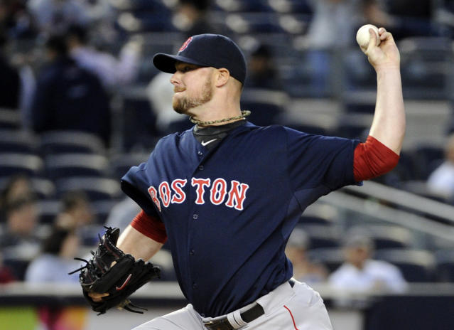 Boston Red Sox pitcher Jon Lester delivers the ball to the New York Yankees during the first inning of a baseball game Friday, April 11, 2014, at Yankee Stadium in New York. (AP Photo/Bill Kostroun)