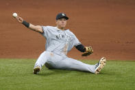 New York Yankees third baseman Gio Urshela throws out Tampa Bay Rays' Brandon Lowe at first after a diving stop during the fifth inning of a baseball game Saturday, April 10, 2021, in St. Petersburg, Fla. (AP Photo/Chris O'Meara)