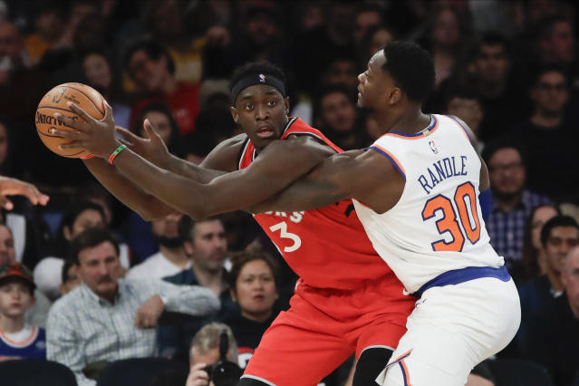 Toronto Raptors' Pascal Siakam (43) protects the ball from New York Knicks' Julius Randle (30) during the second half of an NBA basketball game Friday, Jan. 24, 2020, in New York. (AP Photo/Frank Franklin II)