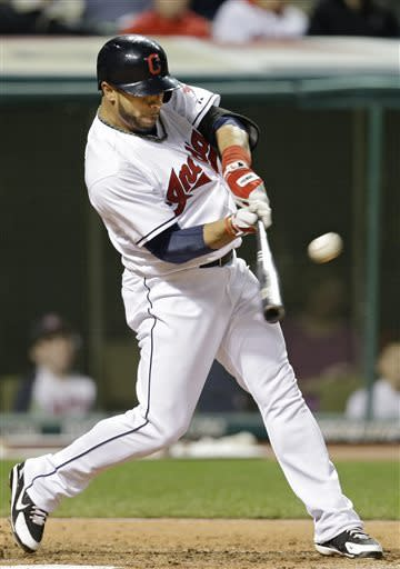 Cleveland Indians' Mike Aviles doubles off Boston Red Sox starting pitcher Jon Lester in the fifth inning of a baseball game on Thursday, April 18, 2013, in Cleveland. (AP Photo/Mark Duncan)