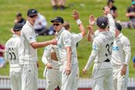 New Zealand's players celebrate their victory against West Indies in the first Test cricket match at Seddon Park in Hamilton on December 6, 2020.