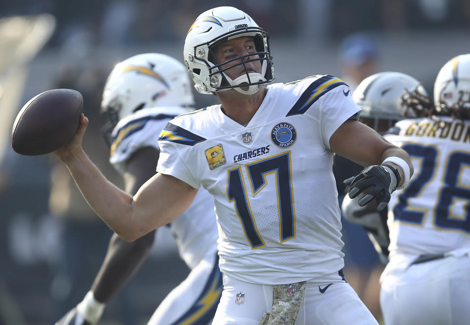 Los Angeles Chargers quarterback Philip Rivers (17) passes against the Oakland Raiders during the first half of an NFL football game in Oakland, Calif., Sunday, Nov. 11, 2018. (AP Photo/Ben Margot)