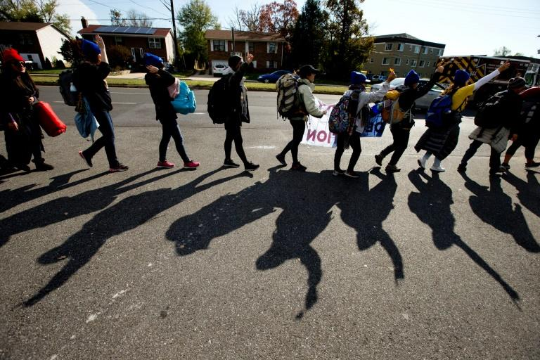 "Dozens of young ""Dreamer"" migrants are seen walking through Langley Park, Maryland, en route to the US Supreme Court, where their fate will be decided (AFP Photo/Jose Luis Magana)"