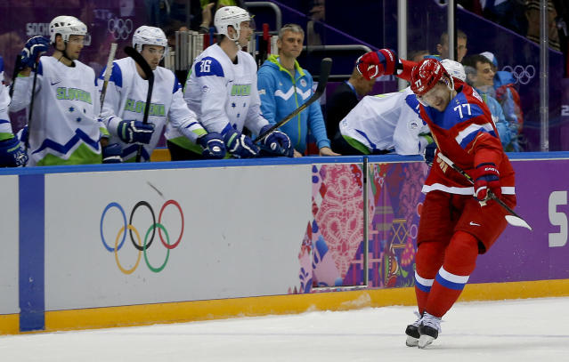 Russia defenseman Anton Belov reacts after scoring a goal against Slovenia in the third period of a men's ice hockey game at the 2014 Winter Olympics, Thursday, Feb. 13, 2014, in Sochi, Russia. (AP Photo/Julio Cortez)