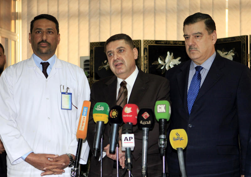 Dr. Essam Namiq, center, deputy Health Minister speaks as Dr. Hani Moussa, left, head of the Iraqi medical team supervising treatment of Iraqi president Jalal Talabani, and Iraq Presidential spokesman Naseer al-Ani, right, listen during a press conference at the hospital where Iraqi president Jalal Talabani is receiving treatment in Baghdad, Iraq, Wednesday, Dec. 19, 2012. Talabani's doctors have not formally said that the 79-year-old statesman suffered a stroke, though several other government officials have confirmed that is the case. Foreign medical experts began arriving in Baghdad on Wednesday to assist Iraqi doctors treating ailing President Jalal Talabani, who remains in a Baghdad intensive care unit after suffering a stroke. (AP Photo/ Karim Kadim)