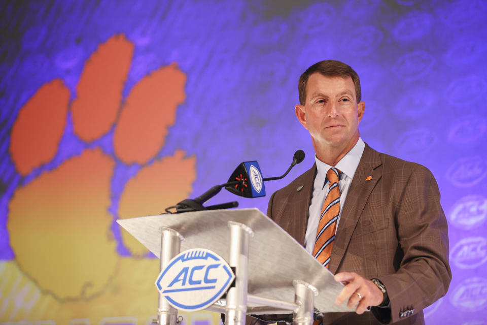 Clemson head coach Dabo Swinney listens to a question during an NCAA college football news conference at the Atlantic Coast Conference media days in Charlotte, N.C., Thursday, July 22, 2021. (AP Photo/Nell Redmond)