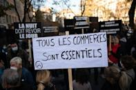 Protesters in Marseille, southern France on Saturday. The banner reads 'All businesses are essential' a reaction to the closure of non-essential outlets