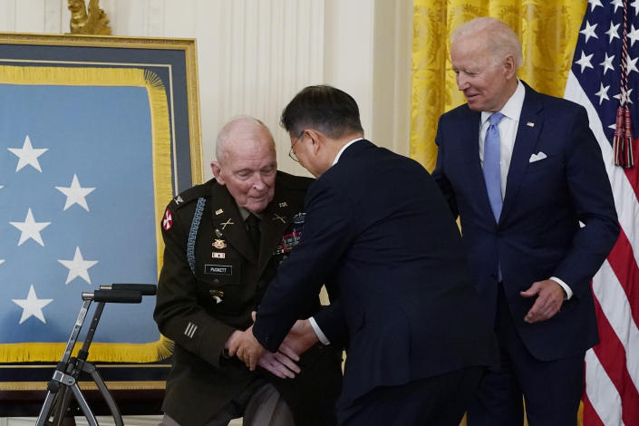 President Joe Biden looks on as retired U.S. Army Col. Ralph Puckett is greeted by South Korean President Moon Jae-in, during a Medal of Honor ceremony in the East Room of the White House, Friday, May 21, 2021, in Washington. (AP Photo/Alex Brandon)