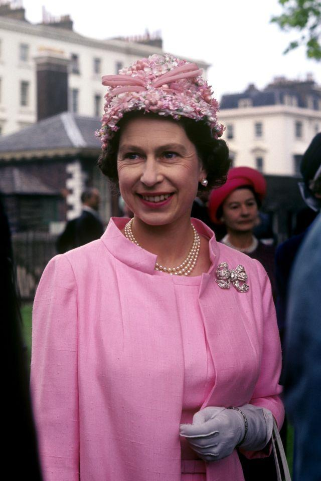 <p>Her Majesty attends a garden party in the grounds of the Royal Hospital in Chelsea, celebrating the 50th anniversary of the Women's Services. (PA Archive) </p>