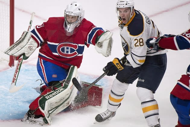 Buffalo Sabres forward Zemgus Girgensons (28) moves in close to Canadiens netminder Zachary Fucale (70) in second period NHL pre-season action at the Bell Centre on Saturday, September 15, 2013. [CP - Graham Hughes]