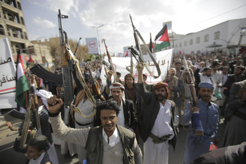 Yemeni Shiite Houthis hold their weapons as they chant slogans during a protest against U.S. President Donald Trump's Mideast plan in Sanaa, Yemen, Friday, Jan. 31, 2020.  (AP Photo/Hani Mohammed)