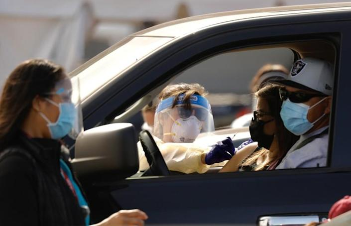INGLEWOOD CA JANUARY 19, 2021 - Drivers pull up to a mass vaccination site in the parking lot of The Forum in Inglewood. The Forum, is one of five mass-vaccination sites opening Tuesday, January 19, 2021 in the county. (Al Seib / Los Angeles Times)