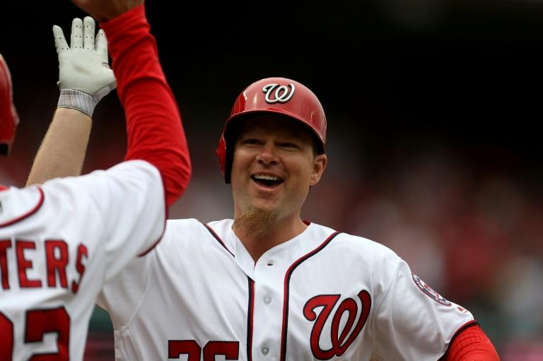 Adam Lind of the Washington Nationals celebrates after hitting a two-run home run against the Miami Marlins in the seventh inning of their opening day game, at Nationals Park in Washington, DC, on April 3, 2017