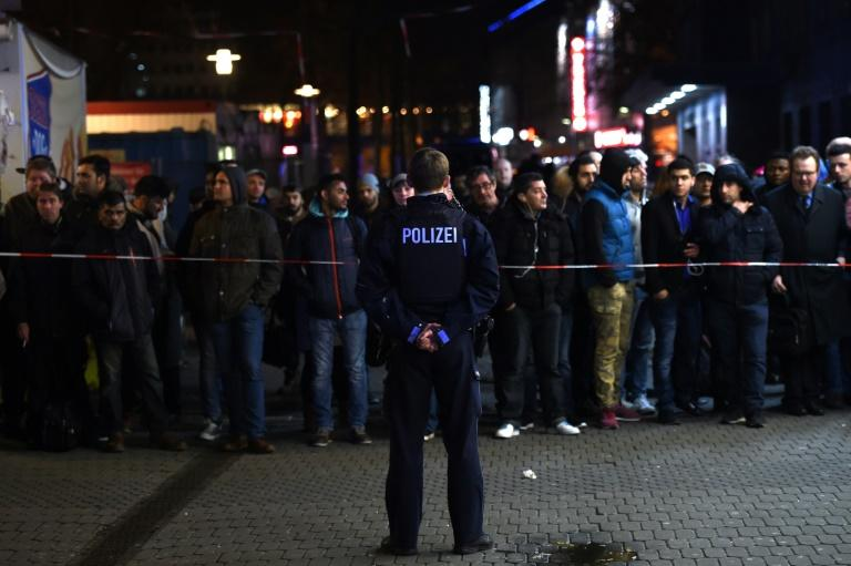 Large numbers of police including heavily armed police commandos were deployed at the main train station in Duesseldorf after a man with an axe attacked passengers