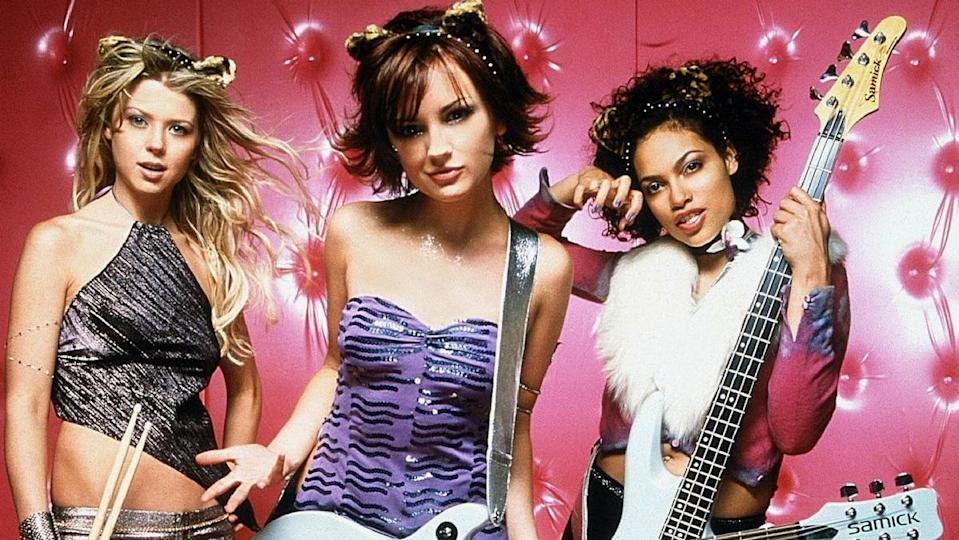 The cast of the 2001 cult classic Josie and the Pussycats strike a pose.