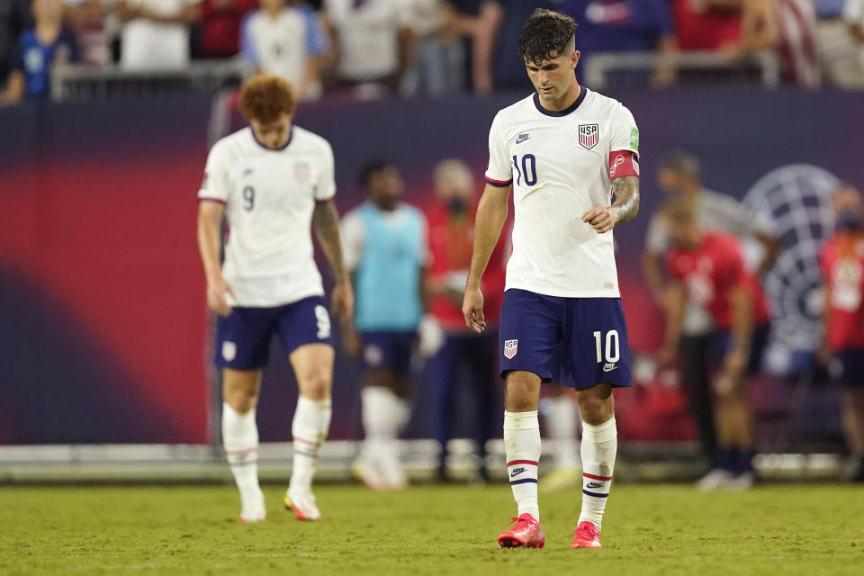 United States forwards Christian Pulisic (10) and Josh Sargent (9) leave the pitch following a 1-1 draw with Canada in a World Cup soccer qualifier Sunday, Sept. 5, 2021, in Nashville, Tenn. (AP Photo/Mark Humphrey)