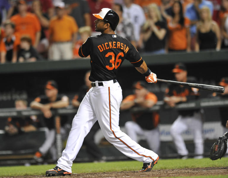 Baltimore Orioles' Chris Dickerson follows through on a three-run walkoff home run to defeat the Detroit Tigers in the ninth inning of a baseball game on Friday, May 31, 2013, in Baltimore. The Orioles won 7-5. (AP Photo/Gail Burton)