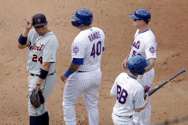 Detroit Tigers first baseman Miguel Cabrera (24) gestures toward the New York Mets dugout after Wilson Ramos (40) reached on a single during the fourth inning of an interleague baseball game, Saturday, May 25, 2019, in New York. (AP Photo/Julio Cortez)