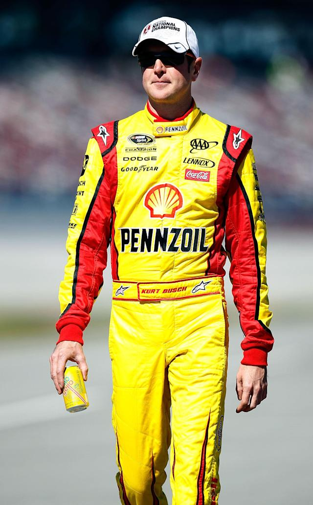 TALLADEGA, AL - OCTOBER 22: Kurt Busch, driver of the #22 Shell/Pennzoil Dodge, walks on pit road during qualifying for the NASCAR Sprint Cup Series Good Sam Club 500 at Talladega Superspeedway on October 22, 2011 in Talladega, Alabama. (Photo by Jeff Zelevansky/Getty Images for NASCAR)