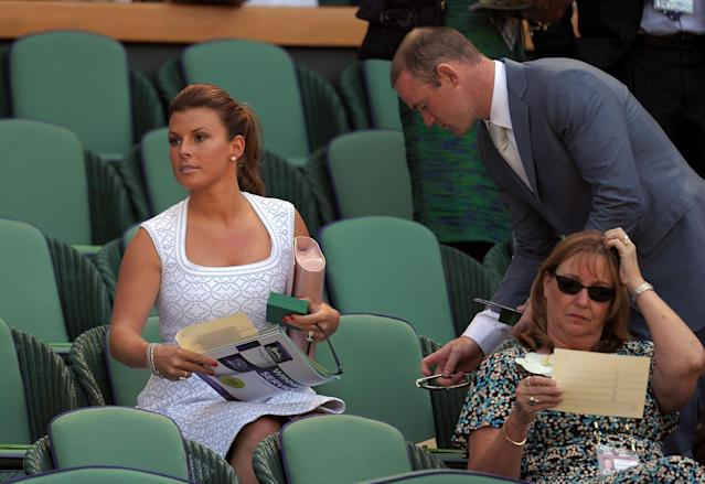 Wayne and Coleen Rooney in the royal box during day thirteen of the Wimbledon Championships at The All England Lawn Tennis and Croquet Club, Wimbledon.