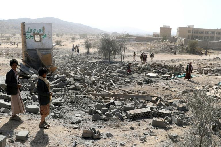 Yemenis inspect damage at the site of a reported air strike by the Saudi-led coalition in Huthi-held Saada province on January 22, 2018