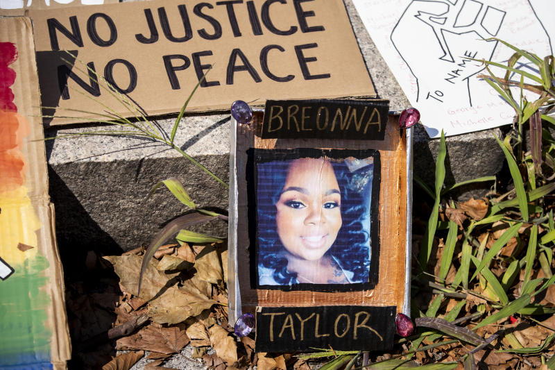 """BROOKLYN, NY - July 25: A line of homemade protest signs lay on the steps including one with a picture of Breonna Taylor for people to pick up and use for the march in Cadman Plaza, Brooklyn. This non-violent protest organized by Unite NY which included thousands of protesters that marched across the Brooklyn Bridge was meant as a statement that the protesters in New York stand in solidarity with in Portland, OR and against federal invasions and in support of Black Lives Matter. Portland has seen federal agents have taken protesters and put into unmarked vehicles while others have been beaten and pepper sprayed. This was billed as a """"We Will Not Be Silenced"""" where organizers asked protesters to bring pots, pans, buckets, whistles anything that can make noise. Protesters continue taking to the streets across America and around the world after the killing of George Floyd at the hands of a white police officer Derek Chauvin that was kneeling on his neck during for eight minutes, was caught on video and went viral. During his arrest as Floyd pleaded, """"I Can't Breathe"""". The protest are attempting to give a voice to the need for human rights for African American's and to stop police brutality against people of color. They are also protesting deep-seated racism in America. Many people were wearing masks and observing social distancing due to the coronavirus pandemic. Photographed in the Brooklyn Borough of New York on July 25, 2020, USA. (Photo by Ira L. Black/Corbis via Getty Images)"""