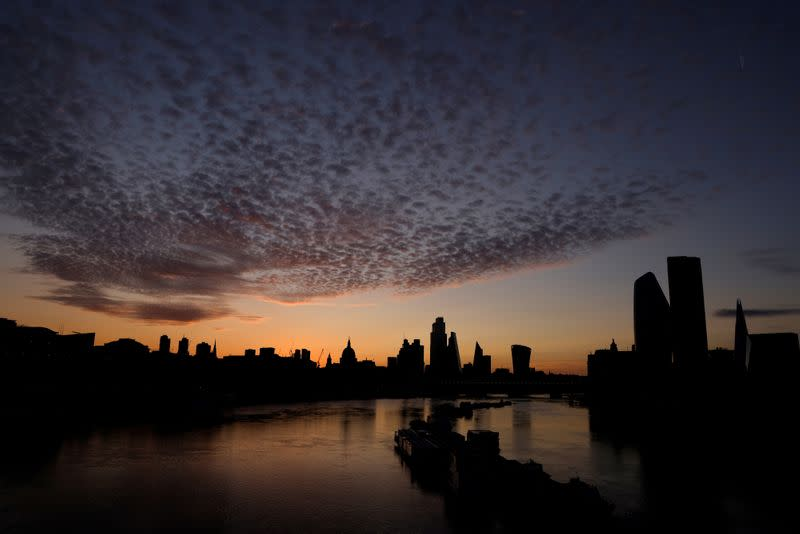 FILE PHOTO: The skyline of St Paul's Cathedral and the City of London is seen before dawn in London