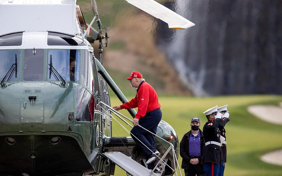 President Donald Trump boards Marine One after golfing at Trump National Golf Club in Sterling, Virginia - Tasos Katopodis/Getty Images