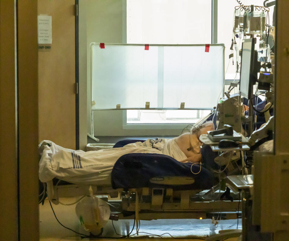 In this Thursday, Aug. 19, 2021, photo, an unidentified patient is monitored at the Critical Care Unit at Asante Three Rivers Medical Center in Grants Pass, Ore. The hospitalization rate of unvaccinated COVID-19 is breaking records and squeezing hospital capacity, with several running out of room to take more patients.(Mike Zacchino/KDRV via AP, Pool)