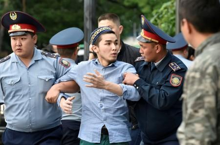 FILE PHOTO: Kazakh opposition supporters hold a rally in Almaty