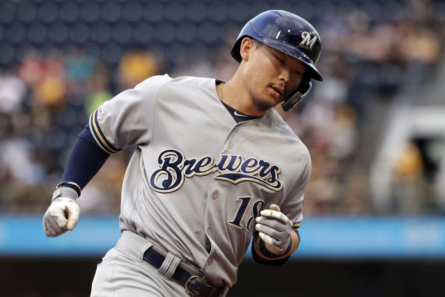 Milwaukee Brewers' Keston Hiura rounds third after hitting a two-run home run off Pittsburgh Pirates starting pitcher Trevor Williams during the first inning of a baseball game in Pittsburgh, Wednesday, Aug. 7, 2019. (AP Photo/Gene J. Puskar)