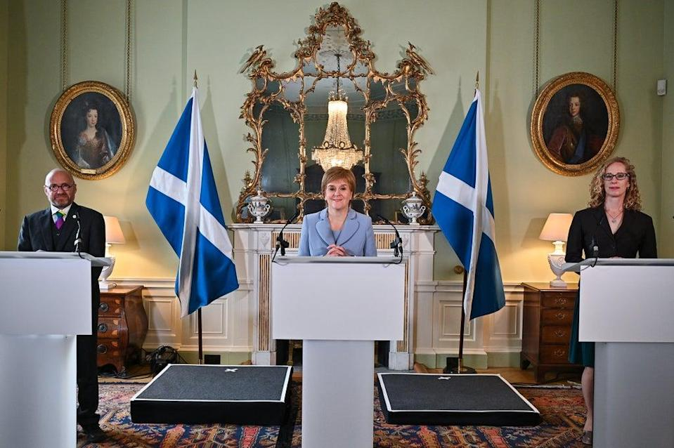 First Minister Nicola Sturgeon (centre) and Scottish Green Party co-leaders Patrick Harvie (left) and Lorna Slater (right) at Bute House, Edinburgh (Jeff J Mitchell/PA) (PA Wire)