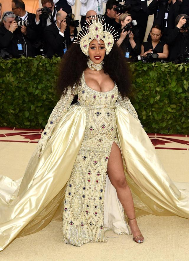 """<p>This <a href=""""https://www.crfashionbook.com/culture/g20267245/met-gala-2018-celebrity-fashion-looks/"""" rel=""""nofollow noopener"""" target=""""_blank"""" data-ylk=""""slk:past year's Met Gala"""" class=""""link rapid-noclick-resp"""">past year's Met Gala</a>, """"Heavenly Bodies: Fashion & The Catholic Imagination<em>,"""" </em>followed the dialogue between fashion and Catholicism. The theme itself was controversial by including the church in adapting pontifical vestments for haute couture. Mom-to-be Cardi B wore a dazzling custom Moschino gown by Jeremy Scott.</p>"""