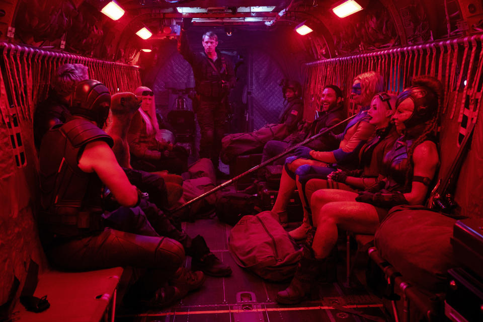 """This image released by Warner Bros. Entertainment Inc. shows Joel Kinnaman, background center, in a scene from """"The Suicide Squad."""" (Jessica Miglio/Warner Bros. Entertainment Inc. via AP)"""