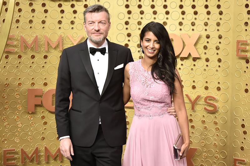 LOS ANGELES, CALIFORNIA - SEPTEMBER 22: (L-R) Charlie Brooker and Konnie Huq attend the 71st Emmy Awards at Microsoft Theater on September 22, 2019 in Los Angeles, California. (Photo by David Crotty/Patrick McMullan via Getty Images)