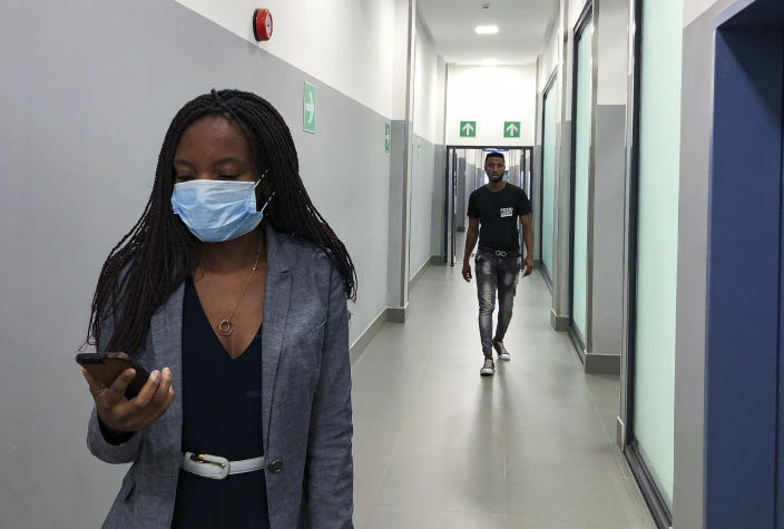 In Feb. 6, 2020, photo, a masked woman walks in a corridor of a shopping mall in Kitwe, Zambia. The coronavirus that has spread through much of China has yet to be diagnosed in Africa, but global health authorities are increasingly worried about the threat as health workers on the ground warn they are not ready to handle an outbreak. (AP Photo/Emmanuel Mwiche)