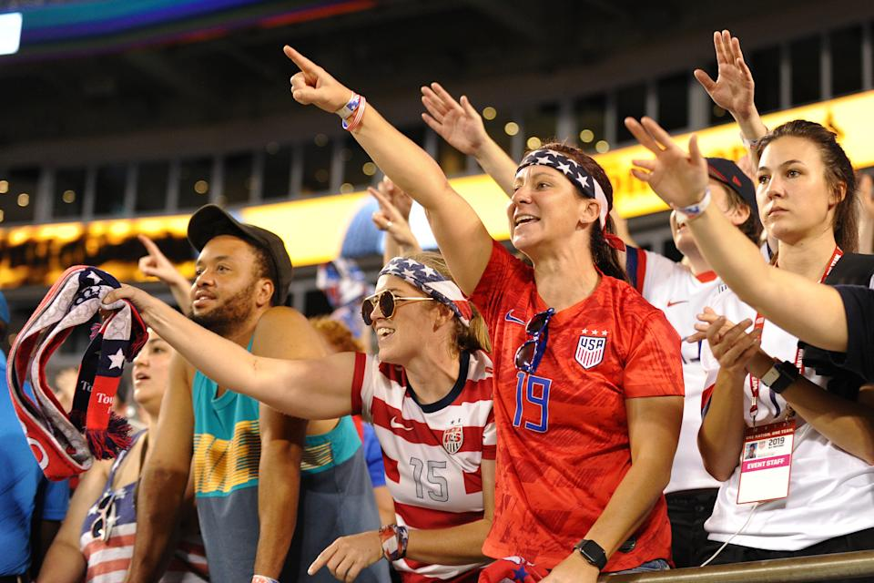 Most fans have had to wear older USWNT jerseys, like the three-star red away kit pictured on the right, instead of the four-star jerseys made after the Women's World Cup this summer. (Getty)