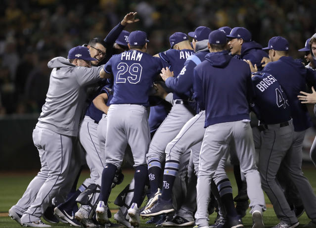 Tampa Bay Rays celebrate after defeating the Oakland Athletics 5-1 after an American League wild-card baseball game Wednesday, Oct. 2, 2019, in Oakland, Calif. (AP Photo/Ben Margot)