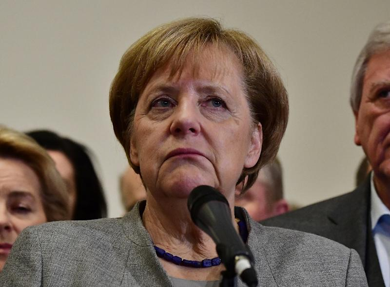 German Chancellor Angela Merkel failed to form a government at the weekend. While the euro and German stocks briefly fell, they quickly rebounded. (AFP Photo/Tobias SCHWARZ)