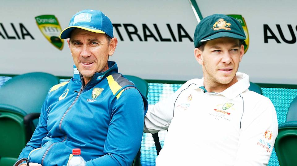Coach Justin Langer (pictured left) sits next to Australian captain Tim Paine (pictured right).