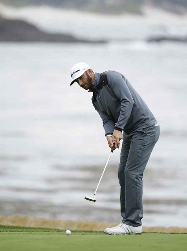 Dustin Johnson putts on the 18th green of the Pebble Beach Golf Links during the final round of the AT&T Pebble Beach Pro-Am golf tournament Sunday, Feb. 9, 2014, in Pebble Beach, Calif. Johnson finished tied for second place after shooting a 6-under-par 66 to finish at total 10-under-par. (AP Photo/Eric Risberg)