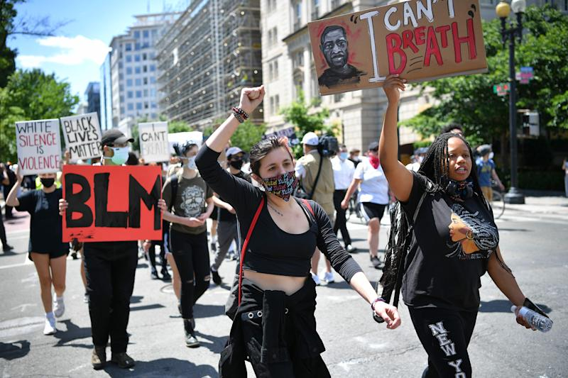 People protest the death of George Floyd, an unarmed black man who died while being arrested and pinned to the ground, down the street from the White House in Washington, DC on June 1, 2020.