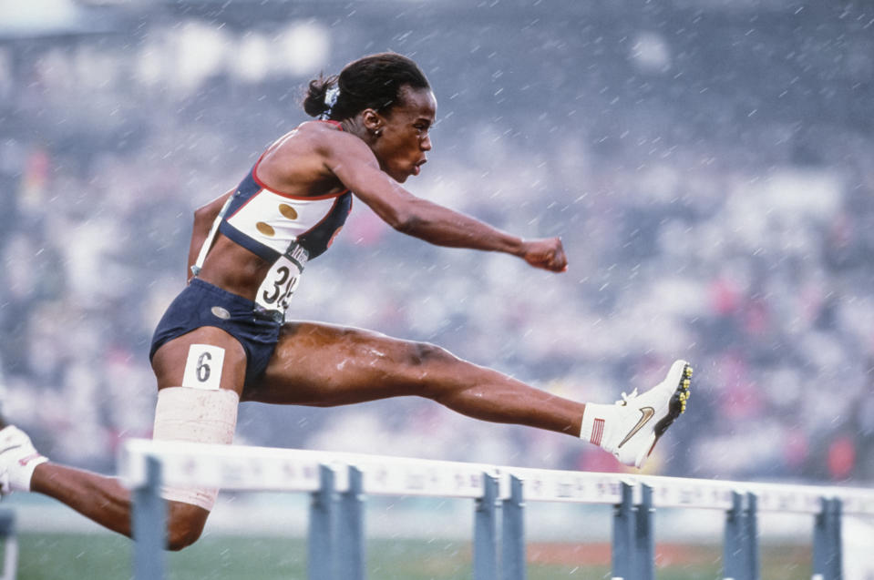 ATLANTA - JULY 27:  Jackie Joyner-Kersee of the USA runs the 100 meter hurdle race of the Heptathlon event of 1996 Summer Olympics on July 27, 1996 in the Centennial Olympic Stadium in Atlanta, Georgia.  (Photo by David Madison/Getty Images)