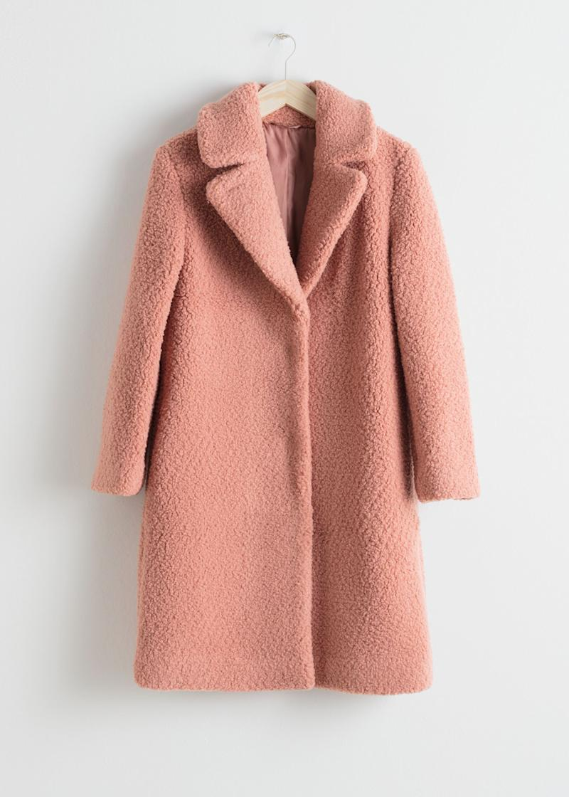 "This pink&nbsp;teddy coat has large lapels, invisible button closures and side seam pockets. <strong><a href=""https://fave.co/2AakXk8"" target=""_blank"" rel=""noopener noreferrer"">Find it for $179 at &amp; Other Stories</a></strong>."